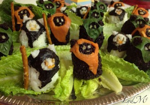 Now these are certainly cute little rice balls. Of course, they have pretzels as spears and lettuce as foliage.