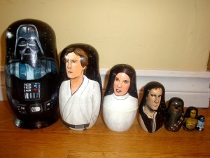 Now these include in descending order: Darth Vader, Luke Skywalker, Princess Leia, Han Solo, Chewbacca, C-3PO, and R2-D2. Made by the same company who did the Hunger Games ones.