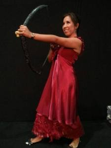 Of course, Katniss didn't shoot any arrows in a red dress. Well, as far as I know. But it's nice to imagine.