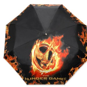"From Zimbio: ""While the kids in the Hunger Games have to worry about their friends murdering them, real world concerns like inclement weather are much less troubling. And although there's no death protection for the tributes, there is this flaming Mockingjay umbrella to help all of us stay dry."""