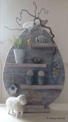 It's a shelf that's shaped like an egg. And it's all decked out for the spring for all your desires.