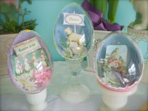 Some of these decorations come from vintage Easter cards. A couple have fake flowers in them.