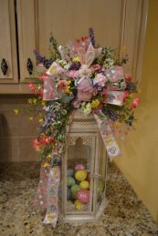 The inside of this is filled with tiny decorated Easter eggs. The outside has a quality Easter bow and flowers.