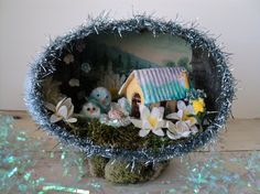 This is a cute diorama. Love the little birds and flowers. Not sure whether the birds are supposed to be babies though.