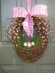 This one even has moss in it and flowers on the handle. And the pink flowers are tied up with a pink polka dot bow.