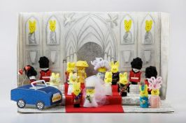 This depicts the royal wedding of Will and Kate which was a few years ago. Now they have 2 kids.