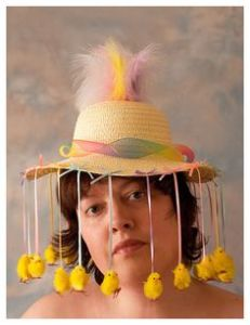 Yes, the pom pom chicks are hanging from the hat. But at least they're there for the portrait.
