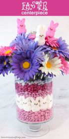 Vase is also filled with jellybeans and marshmallow bunnies, which are candies better for decorating than eating. Also love the flowers.