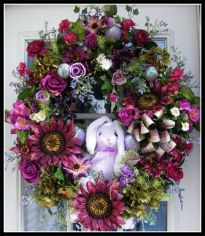 Even without the bunny, this is an incredibly gorgeous floral wreath. Still, the bunny is so cute.