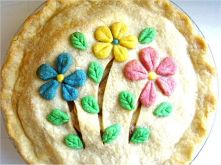 Yes, these are flowers on a pie. And I'm sure the pie filled with fruit and for dessert. Not sure what's in it though.