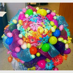 This one seems to have pom poms, eggs, and flowers of almost every color imaginable. Wonder how long it took to make that.