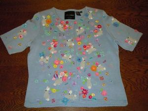 This light blue one uses some degree of sequins to stand out. Also has short sleeves which is odd for a sweater. Then again, Easter takes place in spring.