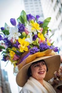 At least this one has a lot of flowers that would be blooming this time of year like crocuses, violets, daffodils, and tulips. But still, it's a crazy hat.