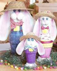 This is a family of bunnies made of flower pots and other attributes. And they're all wearing the same straw hat as well as seem ready for the garden.