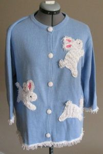 This cardigan just has 3 fuzzy bunnies and white fringe. Yet, these bunnies are adorable.