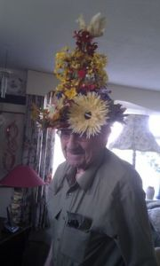 Sure a guy can like flowers if he desires to. Still, like the bird on his head.