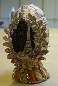 Seems like this one is crafted. And the Eiffel Tower model seems to be from a souvenir shop. Love the laurel leaves.