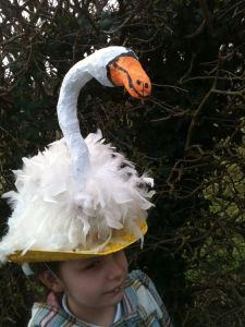 Sure paper mache and white feathers may not make a graceful swan. But I find this hat strangely charming.