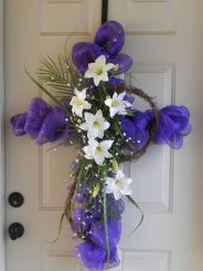 Now this is a lovely cross to hang on your front door. And it's even better because it's purple as well as has flowers.
