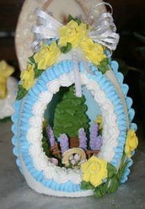 This one has flowers, a tree, and a basket of eggs. It's also decorated with lovely yellow flowers.