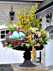 I'm sure the flowers are fake but they sure are vibrant and beautiful. And it has a bird nest in it, too, for blue.
