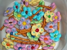 Compared to some of the other stuff on here so far, these seem rather easy to make. All you need are pretzel sticks, M&Ms, jellybeans, icing, and small wafers.
