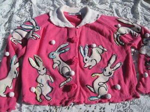 Indeed they do. But on this pink cardigan, there are some pom poms unattached to bunnies as well.