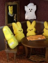 Yes, these peeps are holding a seance from an Oujia board. And a ghost peep has just appeared.