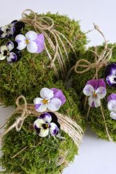 This seems like an interesting idea. And the purple pansies are tied with string. Great for any table large or small.