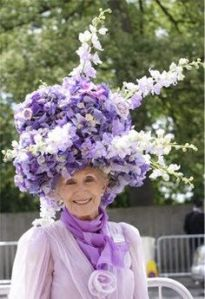 Well, at least it matches her outfit. And it's not among the most outrageous Easter bonnets I've seen lately.