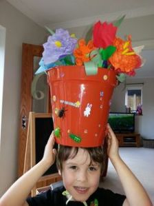 By that, I mean he has a large flower pot on his head. Pretty soon he might end up being a real basket case.