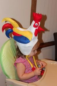 Yes, that's a little rooster hat for a small child. And I'm sure this little girl would fit in with an Easter parade perfectly.