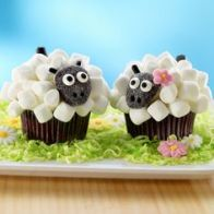 These cupcakes are decorated with marshmallows to resemble wool. Nevertheless, these remind me of the sheep from Wallace and Gromit for some reason. Must be the heads.