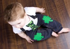 This one has a tie and felt shamrock patches on the knees. Any baby boy is bound to look adorable in it.