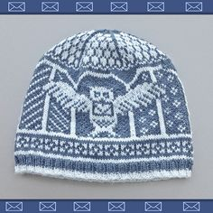 This is a beanie with an owl carrying a letter in it. Not sure if it's Hedwig though.