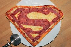 This is a Superman pepperoni pizza. May not be the healthiest thing for you. But I surely appreciate the artistry here.