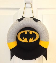 Because the black cape is where you put the bat symbol. A homey addition to any batcave.