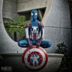 This is a Spider-Man and Captain America mash-up. The suit's in Captain's colors and the shield has a spider on it.