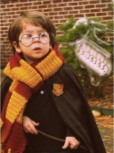 This little one sure makes an adorable Harry Potter. Yeah, I know he's a little young to read the books. But I don't care.