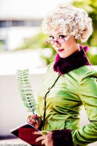 Rita Skeeter is a rather sleazy character in Book 4. I mean when she interviewed Harry, she made a lot of shit up like him having a romance with Hermione. Take off the glasses, this could also work as an Effie Trinket costume.