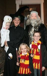 This is good. Love how the parents are dressed as Dumbledore and McGonagall. Love the Hedwig baby, too.