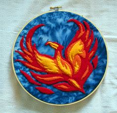 This is a lovely embroirdery piece of Fawkes. Whoever made it really got the color scheme right. Love this.