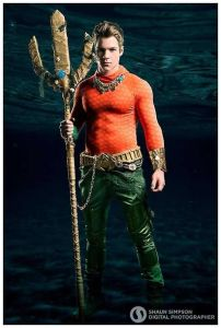 I'm not very familiar with Aquaman either. Still, he's said to be adapted to surviving in the sea and communicate with marine life.