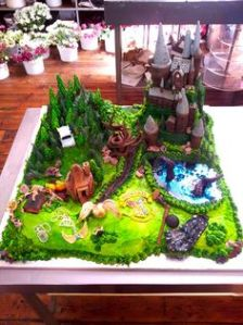 While some cakes features Hogwarts, this one has Hagrid's hut, the Forbidden Forest, the lake, and more. Love it.