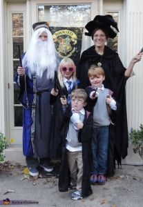 Guess the parents are Dumbledore and McGonagall. The boys are Harry and Ron. And the girl is Luna. Love the Dumbledore beard though.