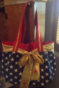 Yes, it's another Wonder Woman purse. But this one is decorated with stars and a gold ribbon.