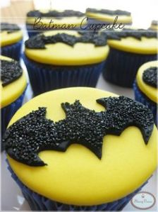 These are just iced yellow with bats on them. Yet, they do have black sprinkles for added effect.