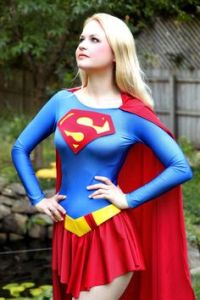 Supergirl is said to be Superman's cousin. And yes, she's blond. However, my dad said he watched the show and it sucks.