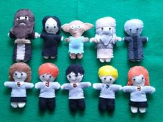 These are made of felt. Includes Harry, Ron, Hermione, Draco, Ginny, Hagrid, Snape, Dobby, Dumbledore, and Voldemort.