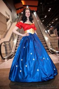 Yes, this is Wonder Woman in a princess ball gown. However, she's not worrying about a midnight curfew or a glass slipper.